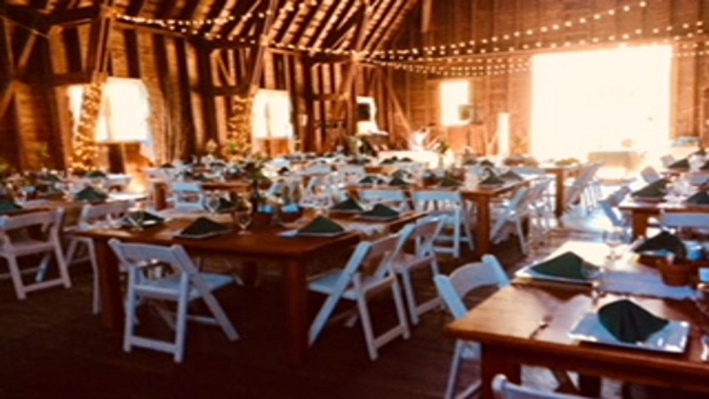 Barn wedding with farm tables