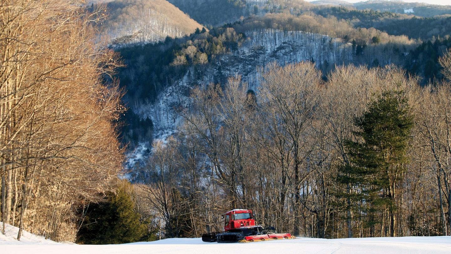 Groomer works on conditions at Suicide Six Ski Area